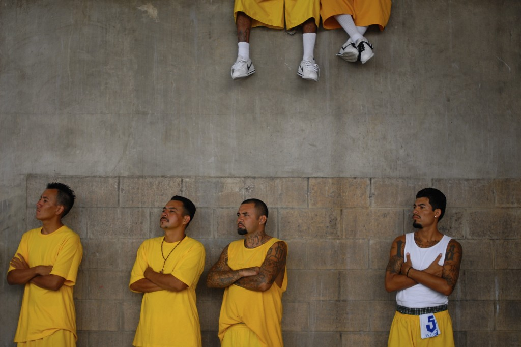 Members of the 18th Street gang attend a mass at the prison of Izalco