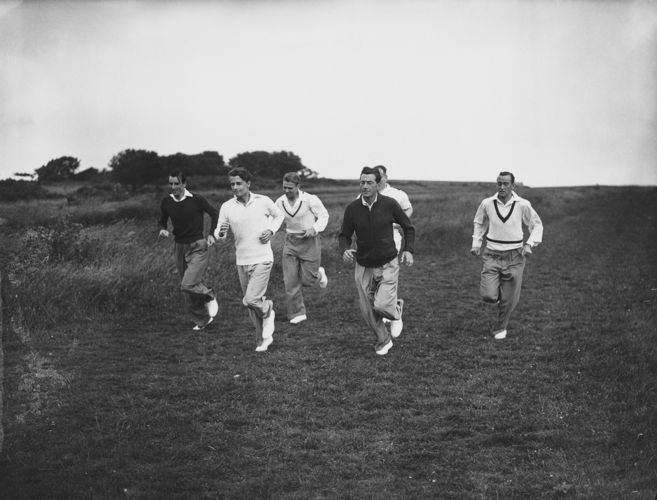 English Davis Cup tennis team members (left to right) Fred Perry (1909 - 1995), Bunny Austin (1906 - 2000), Raymond Tuckey (1910 - 2005), Dan Maskell (1908 - 1992) and Pat Hughes (1902 - 1997) training on Beachy Head, Sussex, 14th July 1936. They are working with Arsenal football club's trainer, Tom Whittaker. (Photo by Topical Press Agency/Hulton Archive/Getty Images)