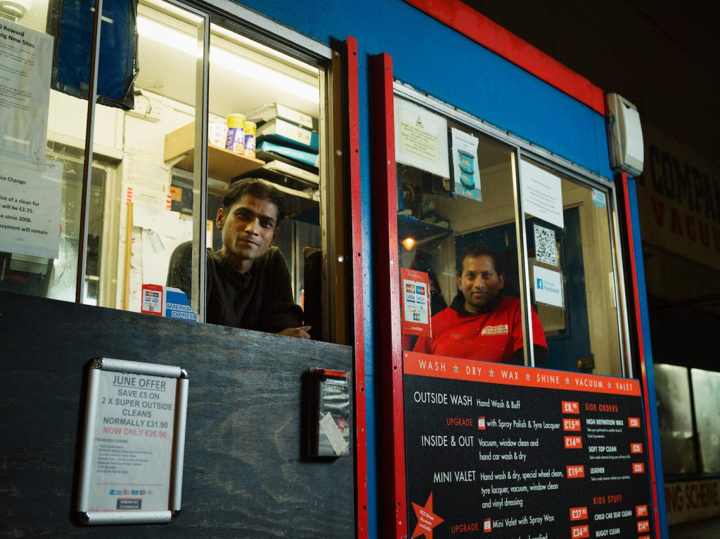 3am Mohammad Ali Chowdury and Rofiki at The American Car Wash Company, Shoreditch Photographed as part of the 24 hour photo story 'The Longest Day - A Portrait of East London' by Tom Oldham on 20th June 2016 Tom shot one portrait every hour from midnight to midnight on the longest day, shooting a huge cross section of the inhabitants of East London
