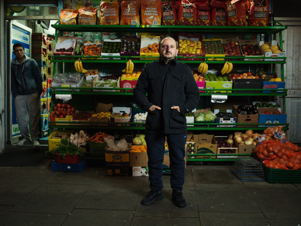 4am Aziz, Uludag Food and Wine, Kingsland Road Photographed as part of the 24 hour photo story 'The Longest Day - A Portrait of East London' by Tom Oldham on 20th June 2016 Tom shot one portrait every hour from midnight to midnight on the longest day, shooting a huge cross section of the inhabitants of East London