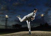 Baseball player pitching off mound